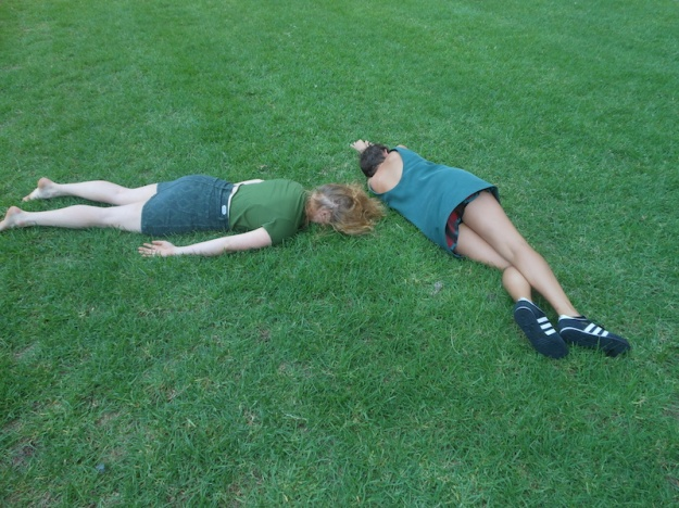 Girls rolling on grass